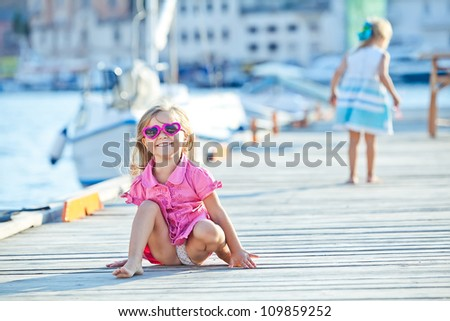 Happy children play in the summer by the sea