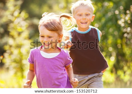 Happy children playing  catch-up game - stock photo