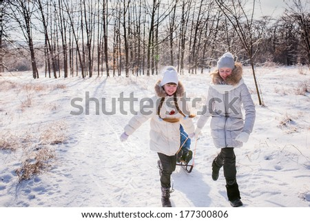 happy children playing in a winter forest