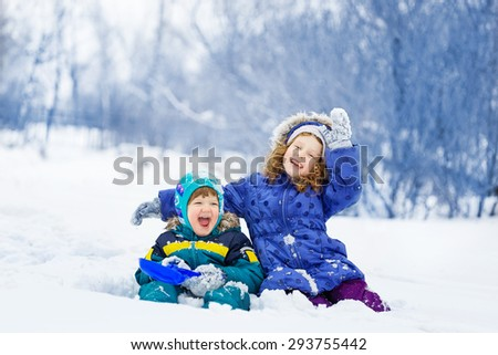 Happy children playing in the winter park. - stock photo