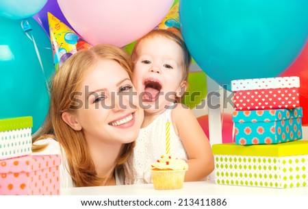 happy children's birthday. mother, baby daughter, balloons, cake, gifts - stock photo