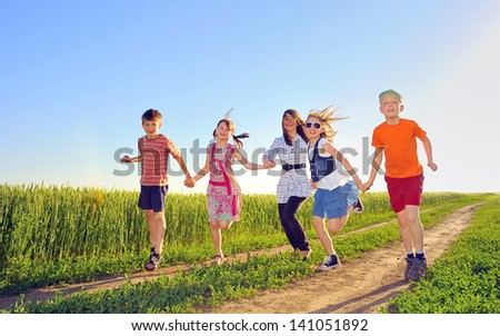 happy children shoot on field in summer time - stock photo
