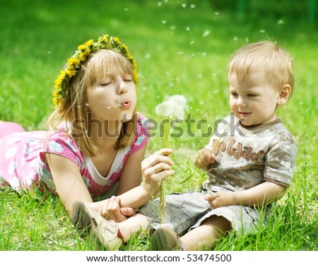 Happy children-sister and brother outdoor - stock photo