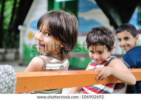 Happy children together outdoor, faces, smiling and careless - stock photo