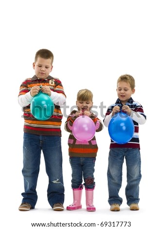 Happy children wearing jeans and striped t-shirt, holding colorful toy balloons, laughing. Isolated on white background.? - stock photo