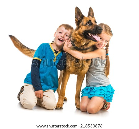 happy children with a dog on a white background isolated - stock photo