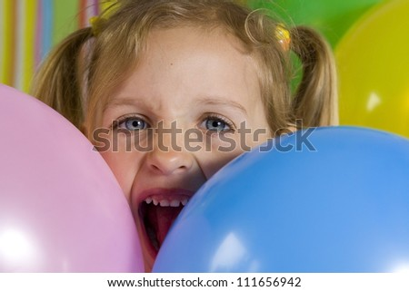 Happy children with baloons on a striped background