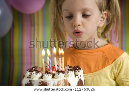 Happy children with birthday cake on a striped background