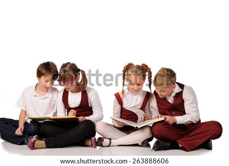 happy children with books siiting on the floor isolated over white background - stock photo