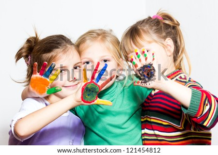 Happy children with colored hands - stock photo