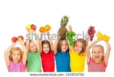 Happy children with fruits - stock photo