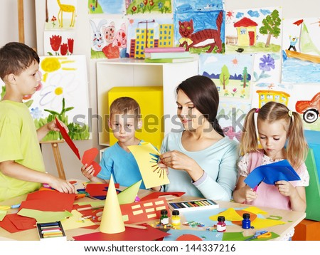 Happy children  with scissors at classroom. - stock photo