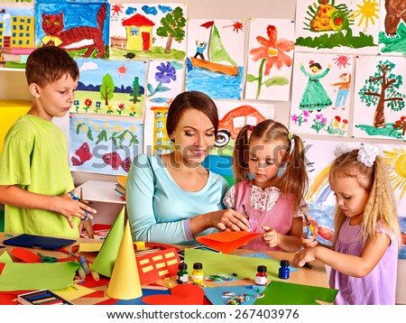 Happy children  with scissors at classroom. Kids education. - stock photo