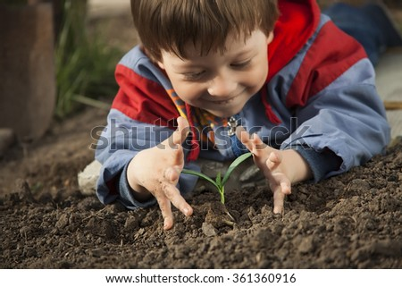 happy children with sprout in hands - stock photo