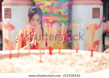 happy Chinese new year. Asian woman with gesture of congratulation. - stock photo