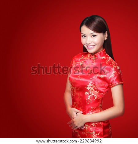 happy Chinese new year. beautiful young Asian woman dress traditional cheongsam - stock photo