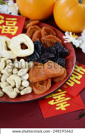 Happy Chinese New Year celebration party tray of togetherness on red wood background. - stock photo