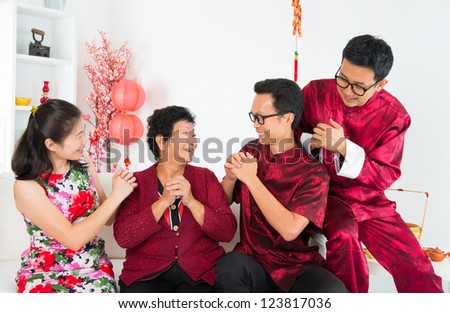 Happy chinese new year. Happy Asian family reunion at home. - stock photo