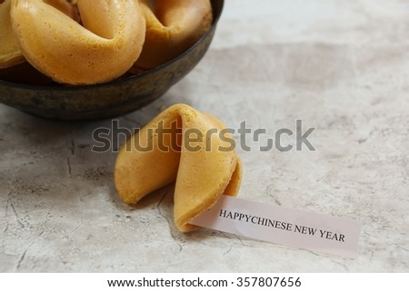 Happy Chinese new year text on Fortune cookies, selective focus - stock photo
