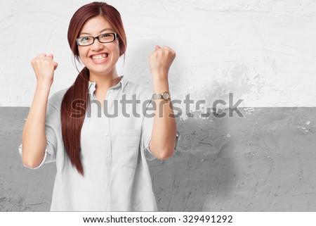 happy chinese woman celebrating success - stock photo