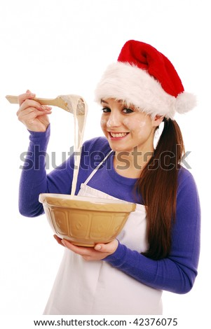 Happy christmas chef with cake mixture on white background - stock photo
