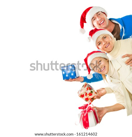 Happy Christmas Family with Gifts. Beautiful Smiling Father, Mother and Daughter wearing Santa's Hat. Border Design - stock photo