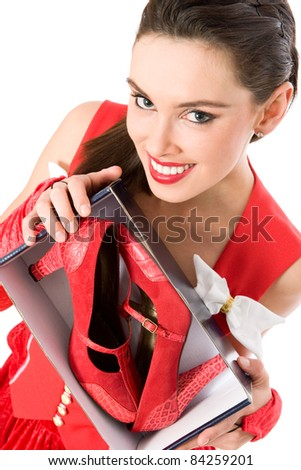 Happy Christmas girl holding box with red shoes - stock photo