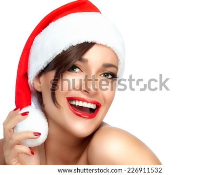 Happy Christmas girl in Santa hat with a beautiful big smile. Sensual red lips and manicure. Fashion portrait isolated on white background with copy space for text - stock photo