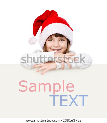 Happy Christmas girl with santa hat behind white board. isolated - stock photo