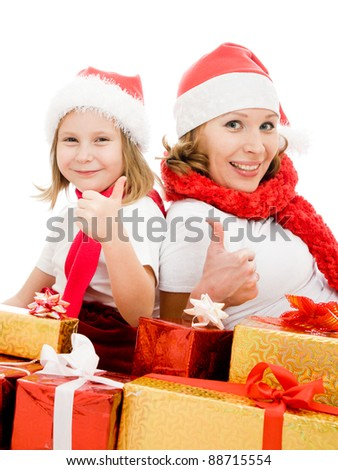 Happy Christmas mother and daughter with presents on a white background.