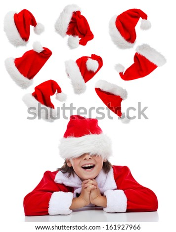 Happy christmas thoughts concept with santa boy having fun - isolated - stock photo