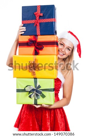 Happy Christmas woman carrying many presents, isolated on white background. - stock photo
