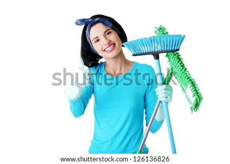 Happy cleaning woman gesturing thumbs up, isolated on white - stock photo
