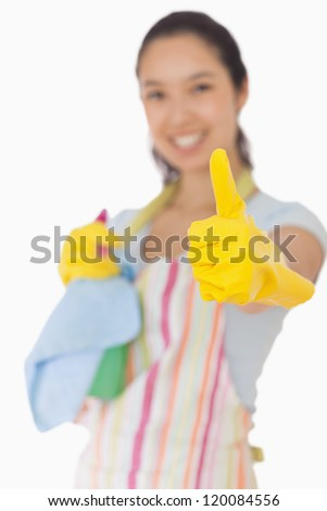 Happy cleaning woman giving thumbs up - stock photo