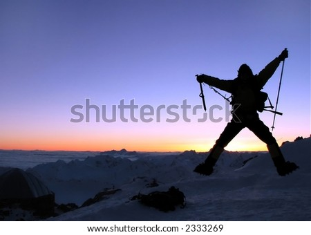 Happy climber on a roof of the world. - stock photo
