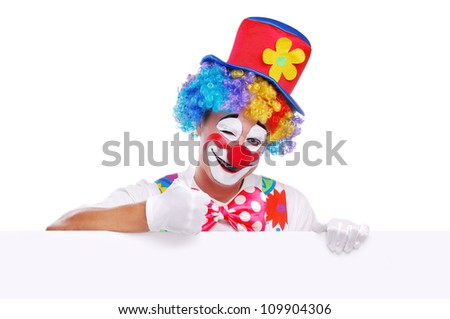 Happy clown holding the blank board showing thumbs up - stock photo