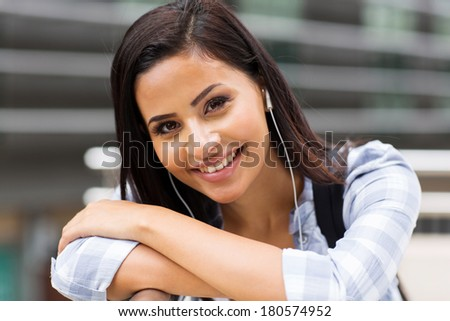 happy college student looking at the camera - stock photo