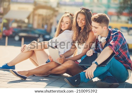 Happy College students on campus - stock photo