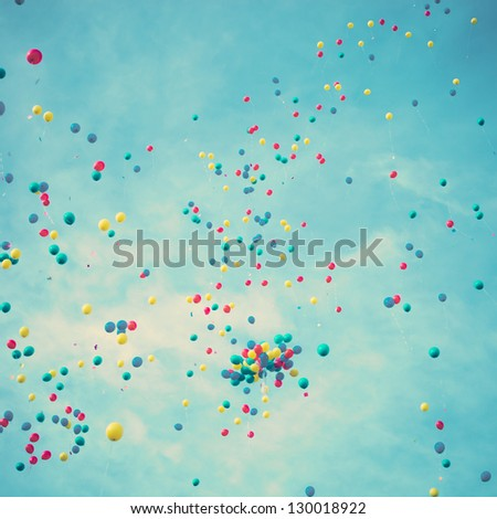 Happy colored balloons in flight - stock photo