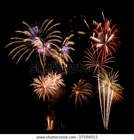Happy colorful fireworks over the deep black night sky - stock photo