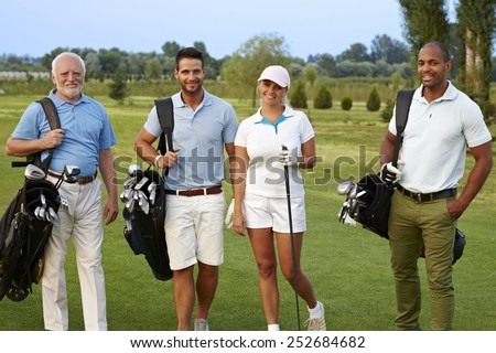 Happy companionship smiling on golf course. - stock photo