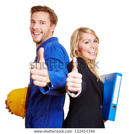Happy construction worker in overall and business woman holding their thumbs up - stock photo