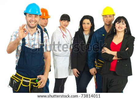 Happy constructor worker showing okay sign hand gesture in front of people group with different careers over white background - stock photo