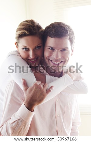 Happy couple at home