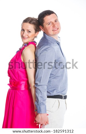 Happy couple. Attractive man and woman being playful. Isolated on white background.