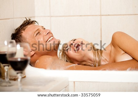 Happy couple bathing - stock photo