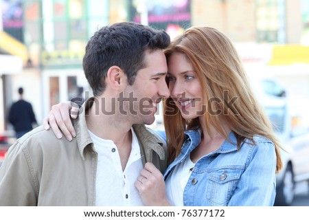 Happy couple doing shopping in town - stock photo