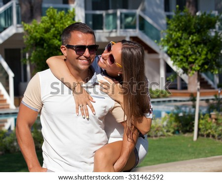 Happy couple embracing, spending romantic time together. Vacations And Tourism Concept. - stock photo
