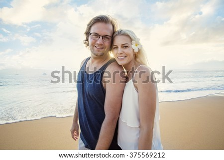 Happy couple enjoying an exotic island honeymoon together - stock photo