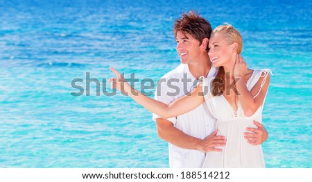 Happy couple enjoying beach, young family in love spending honeymoon vacation on luxury islands, cheerful active young people having fun at summertime travels, joy of life concept - stock photo